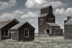 forgotten town (mcgillies) Tags: old sky canada abandoned grass clouds rural wind country neglected forgotten ghosttown weathered swingset prairie saskatchewan grainelevator bents