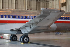 McDonnell Douglas MD-80, American Airlines, DFW maintenance, starboard wing, flap hinges, fuselage fairing, main gear wheels (wbaiv) Tags: americanairlines aa md80 dfw walkaround airplane plane aircraft flying machine landing gear wheel wells tire alighting