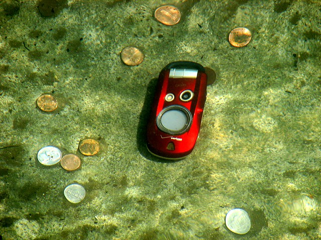 Cell Phone and Coins in Water