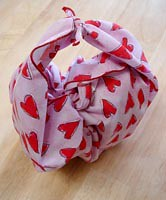 A quick how-to:  The furoshiki purse-tie