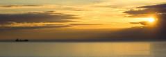 nave al tramonto (zecaruso) Tags: sunset sea italy sun gold boat barca italia tramonto mare ship or nikond70s cargo nave sicily caruso sole palermo acqua ciccio oro mondello aspra vessell addaura bellapalermonline zecaruso cicciocaruso
