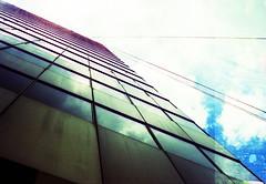 Angles of incidence (Graustark) Tags: sky building film skyscraper 35mm xpro crossprocessed texas houston rangefinder ropes canonet canonetgiiiql17 fujiprovia100