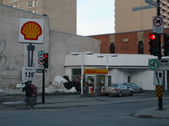 Shell Stations in Montreal: Sainte Catherine Street at Lambert-Closse Street. (Steve Brandon) Tags: road canada trafficlights sign geotagged montral quebec montreal shell gasstation qubec signage rue servicestation petrolstation  ruestecatherine fillingstation ruesaintecatherine  royaldutchshell stecatherinestreet   shelloil   ruelambertclosse  feuxdecirculation lambertclosse   shelllogo saintecatherinestreet shellsign  lambertclossestreet  shelloillogo
