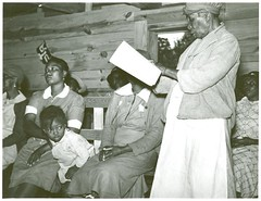 Star pupil, 82 years old, reading her lesson in adult class, Gee's Bend, AL, 1939...
