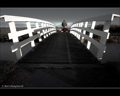 Crossing .. (bert.raaphorst) Tags: bridge bike landscape crossing perspective passing bicyclette crossingover whitebridge biogon21mm leicam8 lightingbridge crossingby bridgetotheotherside passingbybike itriedahandsstand