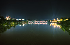 View Along The Vltava (TheFella) Tags: longexposure bridge trees slr castle church water night digital photoshop canon reflections river dark flow eos photo high europe cityscape dynamic czech prague gothic charles praha palace praskhrad unescoworldheritagesite unesco nighttime photograph processing slowshutter czechrepublic flowing dslr charlesbridge range bohemia vltava hdr highdynamicrange karluvmost praguecastle postprocessing vltavariver 500d photomatix