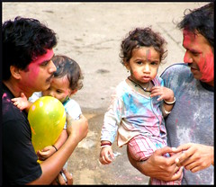 Daddy's girls (World from Ameya's Eye) Tags: baby colors kid holi colorfestival indiafestival indiankid rangpanchami indiancolorfestival coloredbaby