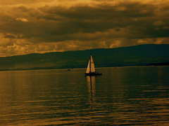 a sail (dafres) Tags: lake mountains reflection water yellow clouds gold boat sailing hills fabulous platinumphoto excapture thebestyellow thegoldproject llovemypics artedellafoto
