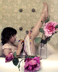 Roses and Rubik's (olivia bee) Tags: flowers roses selfportrait flower feet water rose kid bath child dress tub barefoot faucet teenager bathtub platinumheartaward oliviabee