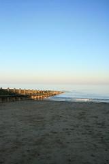Beach Dusk (Dean Brierley) Tags: blue sunset sea sun green beach sand dusk faded shade groyne breaker