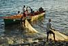 Back from fishing (jendayee) Tags: sunset sea men net water boat fishing rocks waves martinique working tradition anawesomeshot damniwishidtakenthat