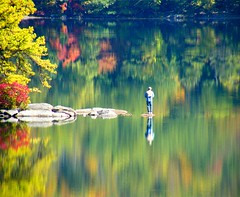 Unreal Autumn (Stanley Zimny) Tags: autumn trees red lake man reflection green fall water mirror fishing rocks seasons vivid unreal reflexions mostfav sterlinglake overtheexcellence mfsz
