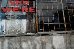 YES WE'RE (Jeremy Stockwell) Tags: wood city windows red urban broken sign concrete nikon missing gone damage weathered damaged urbanlandscape incomplete fromwindow fillintheblank d40 jeremystockwellpix yeswere nikond40
