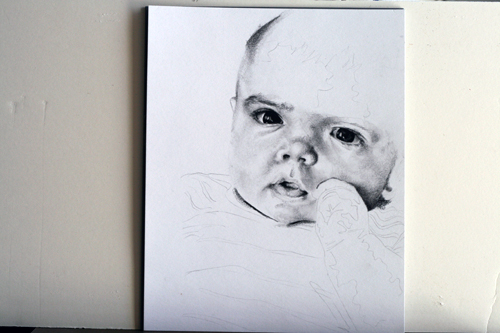 In progress photo of carbon pencil drawing entitled Emre at 4 Months