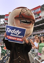Washington Nationals racing presidents Teddy Roosevelt at Nationals Park holding up a Presidents Race Rally Sign from LetTeddyWin.com.