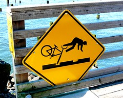 Warning: Getting Bicycle Tire Stuck in Tracks May Cause Loss Of Hands And Feet (sea turtle) Tags: oregon coast pacific ocean pacificocean oregoncoast astoria sign caution warning bicycle fall