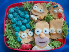 The Simpsons Bento (LoveBones) Tags: blue green cheese breakfast turkey tomato lunch toddler bart lisa maggie raisins lettuce frenchtoast homer bento thesimpsons lunchbox marge waffles cartoons blackolives capncrunch