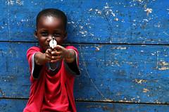 Looking Down the Barrel of a Gun (AdamCohn) Tags: boy smile gun play african ghana westafrica toygun koforidua adamcohn httpwwwadamcohncom