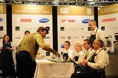 Gwilym Davies - Serving Water (Carl Fleischer Photos) Tags: coffee championship beans glasgow espresso barista cappuchino usbc ukbc scothot gwilymdavies