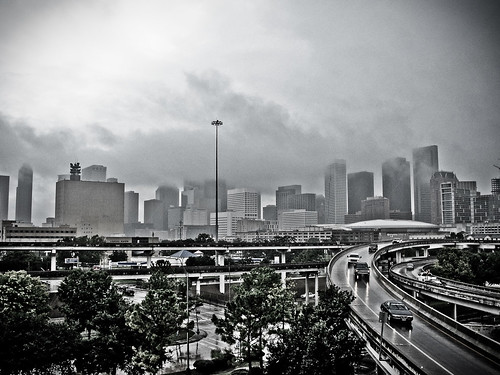 A rain cloud loitering in downtown Houston, TX