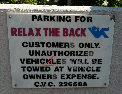 Relax the Back sign: Unauthorized Vehichles Will Be Towed