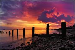 Dawn light over Sheerness (adrians_art) Tags: sky cloud beach reflections boats dawn coast earlymorning pebbles shore groynes seawater sheerness isleofsheppeykentnorth