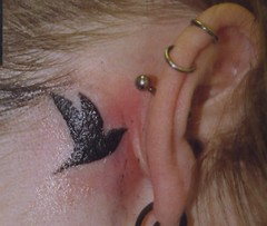 bird tattoo (Bizarre Ink) Tags: bird crow earpiercing eartattoo
