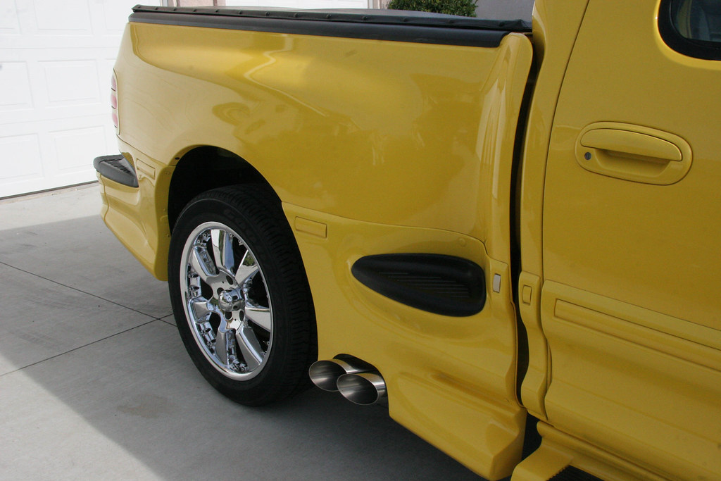 Anyone make a side exhaust with tip in front of rear wheel ...