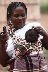 Some Hair care and breastfeeding... same time! Woman and chid portrait, Goba, Mozambique, Africa (E. B. Sylvester) Tags: africa woman child breastfeeding mozambique afrique goba ebsylvester