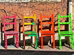 Four colored chairs detail (Daniel Schwabe) Tags: color wall germany chair hannover colorphotoaward colourartaward vividmasters artlegacy