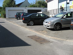 Possible aggregation point - in parking by silver car