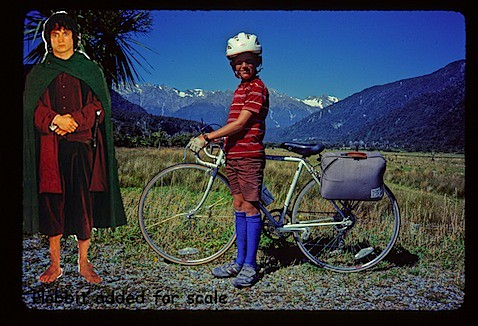1985 standing by bike with hobbit