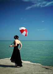 Red and White #3 (Mike Wood Photography) Tags: blue sky woman lake black feet clouds standing umbrella concrete eos pier dress teal bare horizon shore arr polarizer wispy allrightsreserved redandwhite umbrellacorp mikewood 400d aplusphoto mikewoodphotographycom ©mikewoodphotography misslizzz