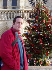 Chris by the the Christmas tree in front of Notre Dame (Chris Devers) Tags: 2003 christmas trip travel chris decorations light vacation paris france building tree me church pine architecture daddy lights louis europe honeymoon catholic ledefrance cathedral religion gothic eu christmastree christian christmaslights notredame ornament hugo decorate iledefrance notredamedeparis fra romancatholic parisfrance victorhugo frenchgothic archbishop ourlady ledelacit flyingbuttress violletleduc romancatholicchurch mauricedesully naturalism thehunchbackofnotredame cdevers exif:exposure=0017sec160 exif:exposure_bias=010ev exif:focal_length=122mm exif:aperture=f56 exif:flash=flashdidnotfireautomode louisvii parisfra popealexanderiii desully exif:iso_speed=80 cameraolympusc50 camera:make=olympusopticalcoltd lens50f18 meta:exif=1257942525 camera:model=x2c50z