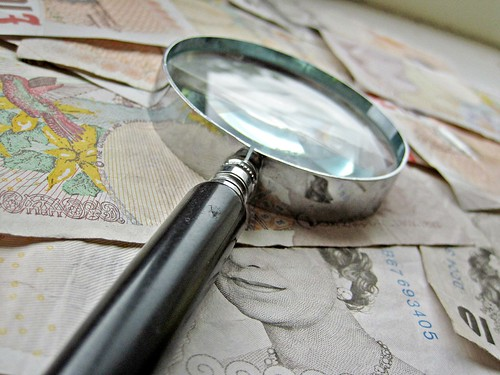 British Money and magnify glass