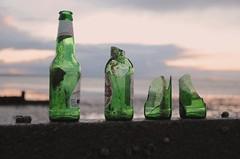 Four green bottles (Strabanephotos) Tags: sunset england green beach broken glass kent bottles groyne whitstable