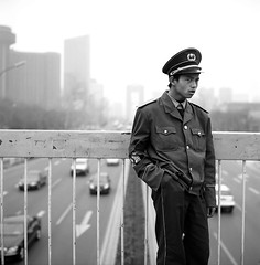 China faces the world (travelight) Tags: china street portrait blackandwhite film rolleiflex action candid beijing serendipity nocrop suspicion stillpoint 28f cmctpponlyinchina nothcsp travelight machinescan
