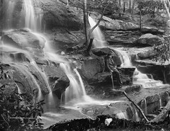 Mosman Bay Falls (Powerhouse Museum Collection) Tags: longexposure blackandwhite bw man blur fall nature water beautiful leaves misty outdoors waterfall rocks eau power wasserfall falls steine waterfalls bowlerhat splash karst bume cachoeira chute powerhousemuseum chutes mockery mosmanbay derbyhat gehstock lonlieness schwarzweis quedadgua posedphotograph sydneysandstone faszinierend xmlns:dc=httppurlorgdcelements11 henryking mossmansbay dc:identifier=httpwwwpowerhousemuseumcomcollectiondatabaseirn31017 focusbokeh mossmansbayfalls mannmitgehstock nomoreuselessnotesplease sujatasharma90hotmailcom