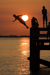 joyously. (kvdl) Tags: sunset summer orange silhouette pier jump action britishcolumbia dive teenagers diving surrey crescentbeach contrejour mudbay vob pierjumping pierdiving kvdl joyously