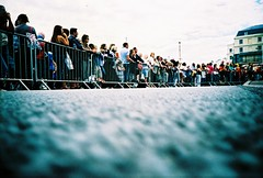 waiting (lomokev) Tags: people lomo lca xpro lomography crossprocessed xprocess low crowd ground lomolca barrier spectators agfa jessops100asaslidefilm agfaprecisa lomograph agfaprecisa100 precisa ratseyeview jessopsslidefilm roll:name=080623lomolcad file:name=080623lomolcad145
