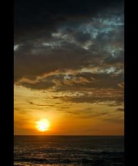 Sunrise (thejasp) Tags: sea india beach colors vertical clouds sunrise d50 dawn nikon scenery dslr sonnenaufgang indien tamilnadu sunup kanyakumari   mobilewallpaper    thejas explored  sdindien  zuidindia indedusud  thejasp malayalikkoottam    flickrlovers