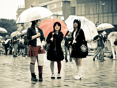 Not singing in the rain (manganite) Tags: school girls red people color cute topf25 beauty fashion socks japan sepia modern digital cutout geotagged asian japanese tokyo costume clothing cool nikon colorful asia pretty y cosplay tl candid young teens style skirt harajuku kawaii fancy teenager  nippon  desaturated uniforms trio d200 nikkor dslr umbrellas toned cuties catchycolor miniskirt girlies nihon kanto skirts stylish japanesegirl girlish  18200mmf3556 utatafeature manganite nikonstunninggallery cutesexy date:year=2006 geo:lat=3566981 date:month=august date:day=12 geo:lon=139702357 format:ratio=43