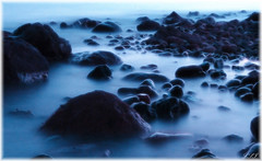 BLUE Ice (Kuzeytac) Tags: longexposure blue light sea color colour ice nature wet silhouette stone turkey geotagged evening scenery view trkiye turkiye aegean wave scene explore geotag siluet deniz mavi leyla assos ege manzara lsi buz k dalga renk akam doa tabiat siyah ta anakkale canoneos400d canoneosdigitalrebelxti ayvack rainbowseries fractalius kuzeytac copyrightedallrightsreserved aqualityonlyclub