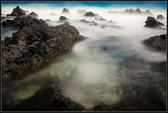Lava y Ocano (Andrea Cucconi) Tags: ocean summer white black beach water island lava spain nikon rocks estate wind turquoise wave lanzarote canarias atlantic spuma espana pietre canary 2008 rocce acqua bianco nero spagna vento oceano isola atlantico turchese onda canarie longexposition d80 oceanshore nikonstunninggallery andreacucconi panoramafotogrfico oceanshoreexcellence