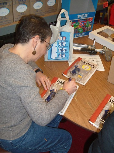 Nancy Pearl Signs an Action Figure at Archie McPhee, September 2003