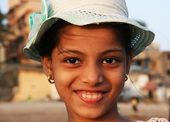 Young Girl with a Pale Blue Hat... (cmac66) Tags: india girl beautiful smile happy eyes child lovely mumbai soe versova versovabeach mywinners naturalbeautyportraiture