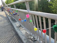 pom pom1 (Eugene Knotty Knitters) Tags: oregon eugene willametteriver altonbakerpark knithappens knitgraffiti knottyknitters internationalyarnbombingday peterdefaziopedestrianbridge