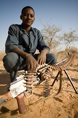 Meet The Janjaweed-20.jpg (Andrew Carter) Tags: fighter sudan arab conflict militia darfur ammo machinegun ammunition crouching janjaweed unreportedworld