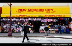 New Mission City (unaesthetic) Tags: sanfrancisco california mission district new city dj systems car stereo speaker sony kenwood boss pioneer etc gemini carver nuwark 2626 electronics furniture houseware gifts toys 4156958768 backpacks dollar store storefront sinage man people peace sign coke black street jaywalking alive peoplepage1