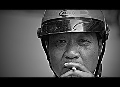 The Stare (Michael Steverson) Tags: china portrait white man black canon asian intense cigarette taxi helmet chinese games smoking explore stare chinadigitaltimes 40 allrightsreserved guangxi expatriate liuzhou motorcycel expatriategames